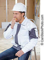construction worker eating an apple