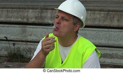 Construction worker enjoy cigarette