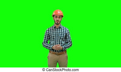 Construction worker enlisting factors for success on a Green Screen, Chroma Key.