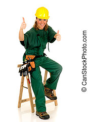 Young attractive female construction worker with green overall and shirt. Studio shot, white background.