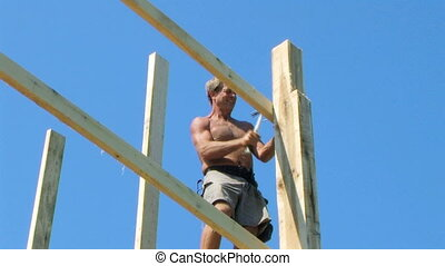 Construction Worker Hammering - Construction worker...