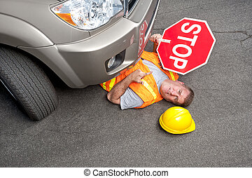 Construction worker hit by car - A construction road worker...