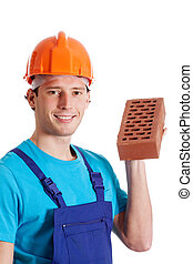 Construction worker holding a brick