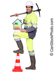 Construction worker holding a pickaxe and an energy efficiency rating sign