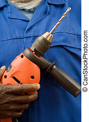 Construction worker holding a power tool