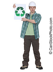 Construction worker holding a recycle sign