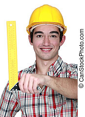 Construction worker holding a try square