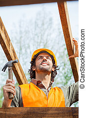 Construction Worker Holding Hammer At Site
