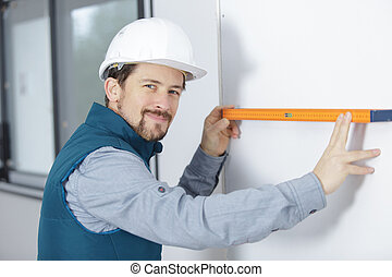 construction worker holding levelling tool