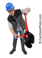 Construction worker holding oversized pliers