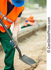 Construction worker holding shovel