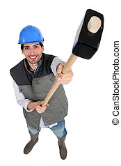 Construction worker holding up a mallet