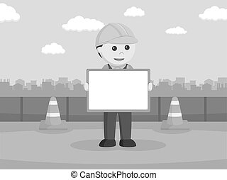 Construction worker holding whiteboard