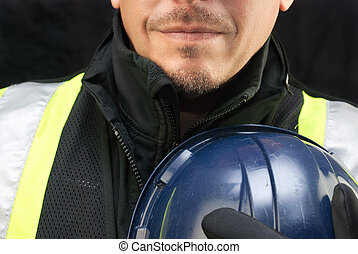 Construction Worker Holds Hard Hat To Chest