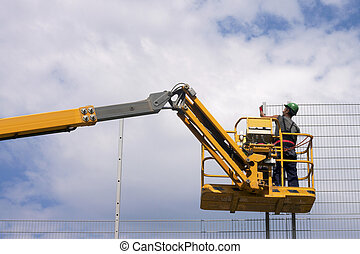 Construction worker - Hydraulic mobile construction platform...