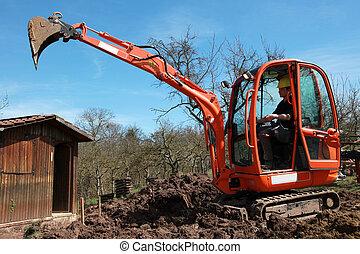 Construction worker in an excavator