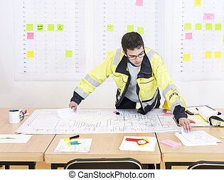 Construction worker in an office