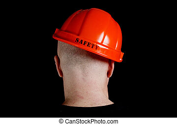 Construction worker in hard hat with an inscription safety...