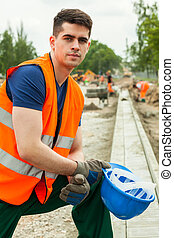 Construction worker in uniform - Portrait of young handsome...