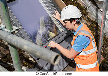 Construction Worker Installing Replacement Window