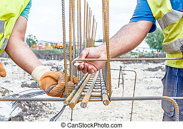 Construction worker is marking place for place to binding rebar at the building site