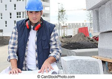 construction worker looking at his plans