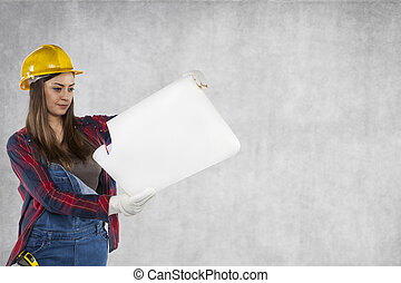 Construction worker looking at plans, copy space