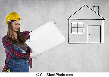 Construction worker looking at plans, new house