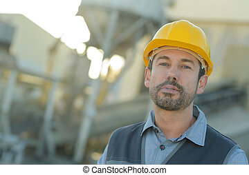 construction worker looking into distance