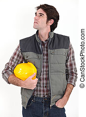 Construction worker looking out of frame