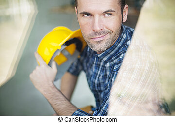 Construction worker looking through the window