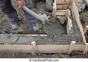 Construction worker making concrete