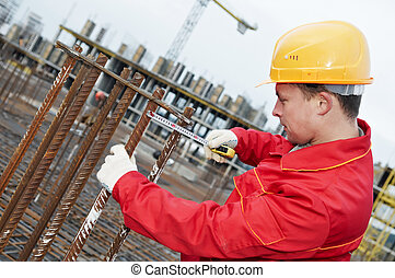 construction worker making reinforcement - builder worker...
