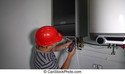 Construction worker man with electric screwdriver mount ...