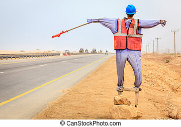 Manequin of a worker used at road construction sites in Oman