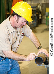 Construction Worker Marking Pipe