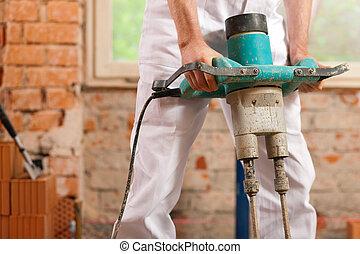 Construction worker mixing concrete