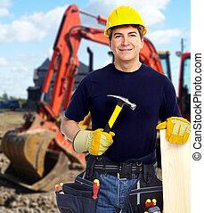 Construction worker near excavator.