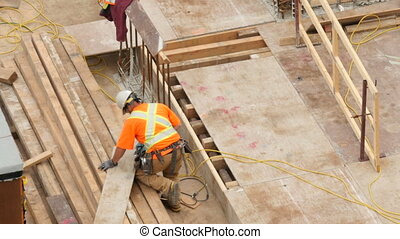 Construction worker on a highrise - Construction worker...