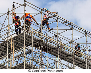 construction worker on a scaffold, symbolfoto for building,...