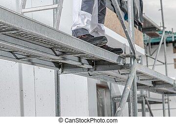 Worker on a Scaffolding