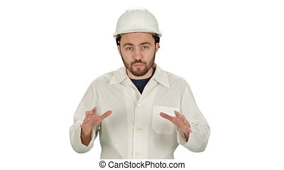 Construction worker on building site talking to camera on white background.