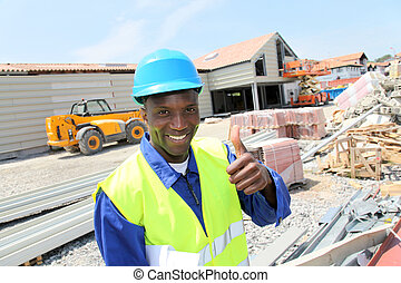Construction worker on building site with security helmet