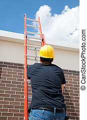 Construction Worker on Ladder - Construction worker using a...