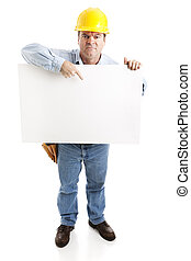 Angry construction worker holding a blank white sign. Full body, isolated on white.