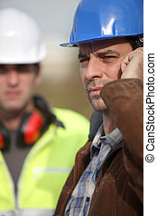 Construction worker on the phone