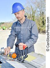 construction worker operating machine