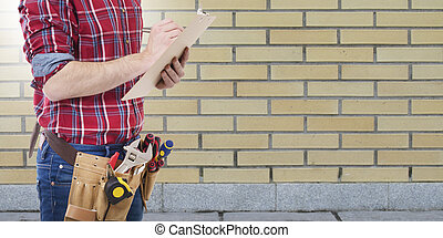 construction worker or architect writing in the documents