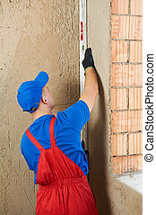 construction worker plasterer with level