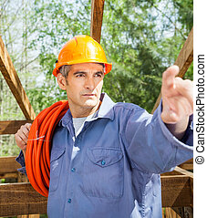 Construction Worker Pointing At Site